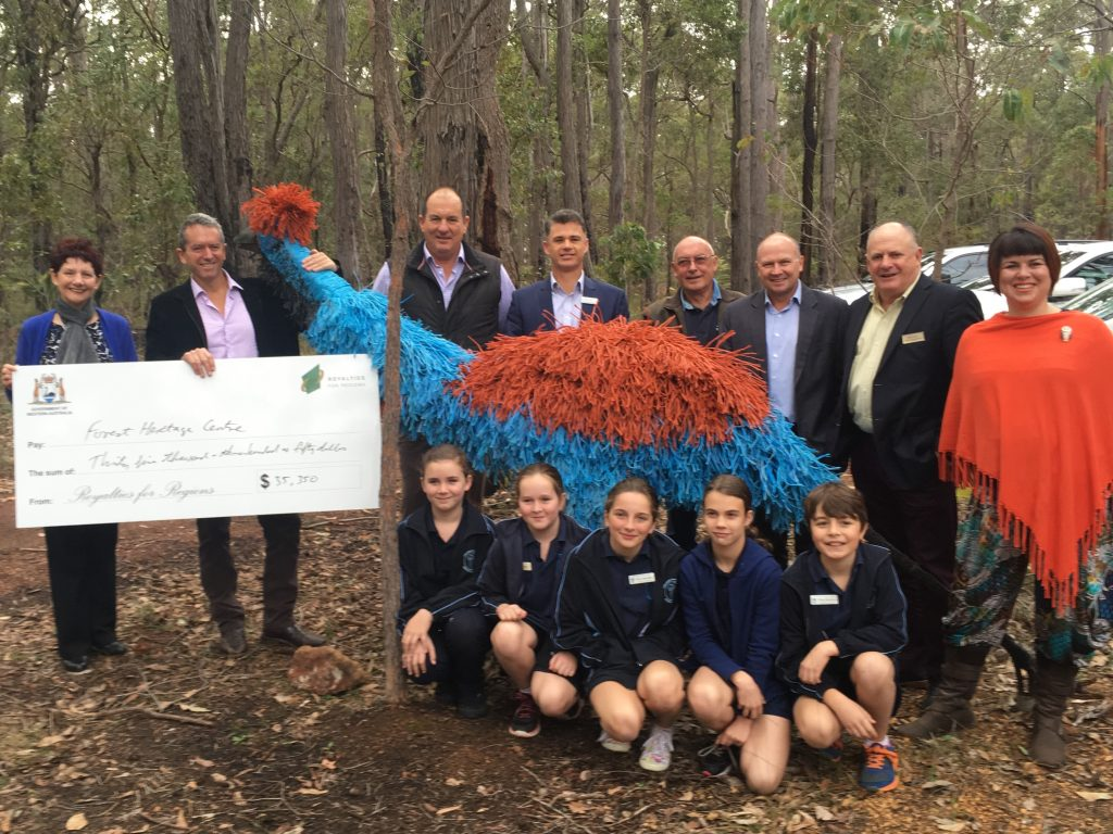 Minister Terry Redman and FHC Chair Sue Fyfe pictured with guests at the relaunch and the cheque for the Emu Walk Trail.